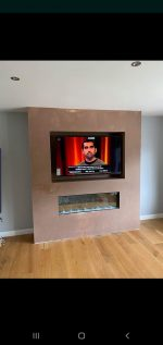 False chimney brest , inserted fireplace and recessed TV
